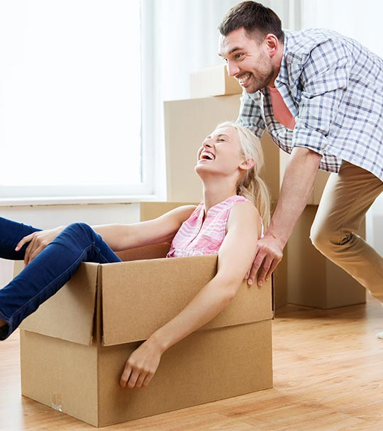 man pushing woman in moving box
