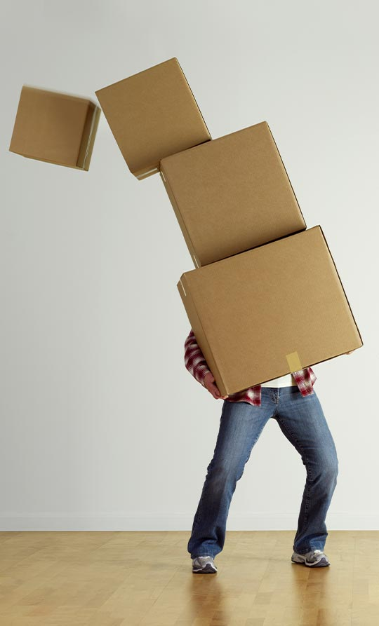 man with too many moving boxes